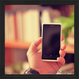 Picture of a man holding a cell phone