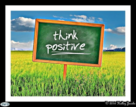 "A sign that states ""Think Positive"" on it."